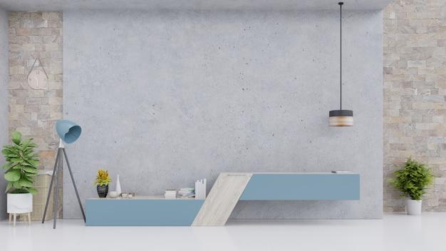 Armoire bleue dans une salle vide moderne avec mur et sol en béton. Photo Premium