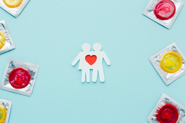 Arrangement Du Concept De Contraception Avec Couple De Papier Photo Premium