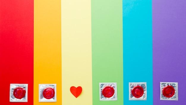 Arrangement De Méthode De Contraception Sur Fond Arc-en-ciel Photo gratuit