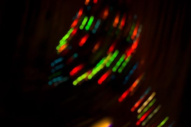 Arrière-plan flou du concert de bokeh de nuit. lumières de la scène au concert. éclairage de concert défocalisé. Photo Premium