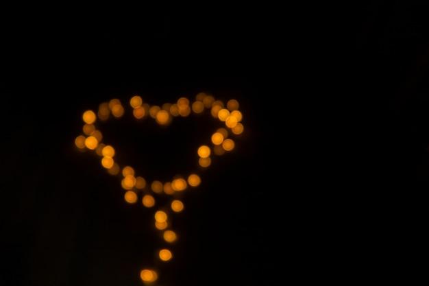 Arrière-plan Flou Des Lumières En Forme De Coeur. Thème De La Saint-valentin. Photo Premium
