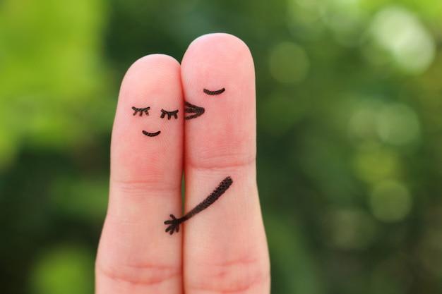 Art Des Doigts De Couple Heureux. Un Homme Embrasse Une Femme Sur La Joue. Photo Premium