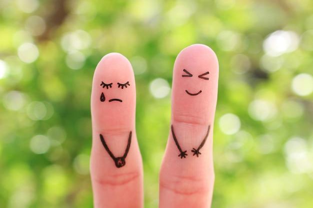 Art Des Doigts Du Couple. La Femme Pleure, L'homme Rit. Photo Premium