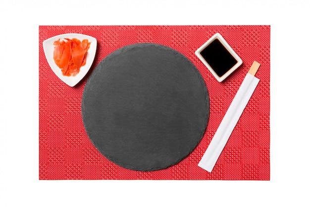 Assiette Ardoise Noire Emptyround Avec Baguettes Photo Premium