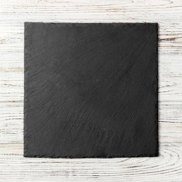 Assiette carrée noire Photo Premium