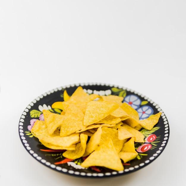 Assiette avec de délicieux nachos Photo gratuit