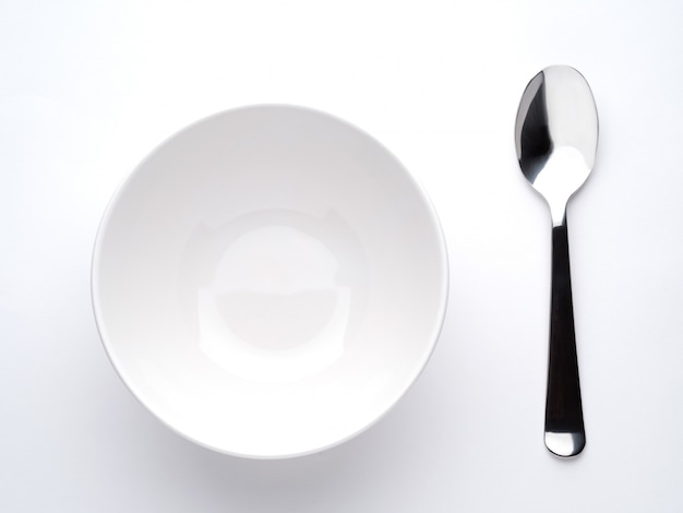 Assiette à soupe profonde et cuillère Photo Premium