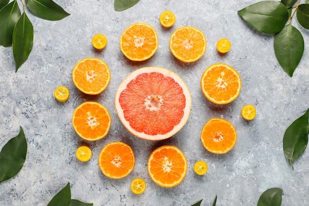 Assortiment D'agrumes Frais, Citron, Orange, Citron Vert, Mandarine, Kumquat, Pamplemousse Frais Et Coloré, Vue De Dessus Photo gratuit