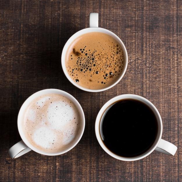 Assortiment De Café Noir Et De Café Au Lait à Plat Photo gratuit