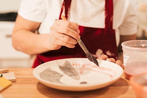 Atelier de fabrication de produits de vaisselle en céramique Photo gratuit