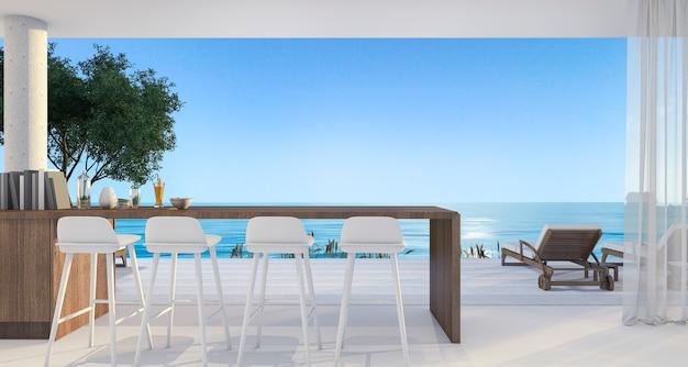 Bar dans une petite villa près de la belle plage et de la mer à midi avec un ciel bleu Photo Premium