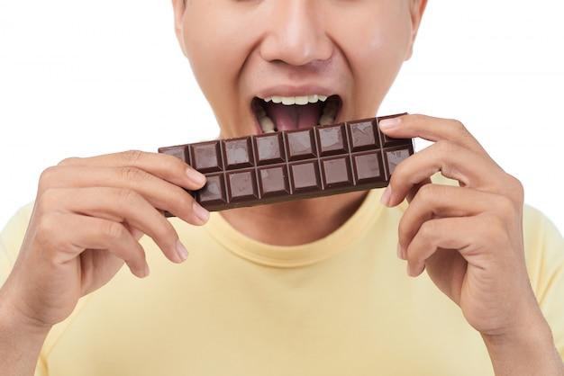 Barre de chocolat mordante aux dents sucrées Photo gratuit