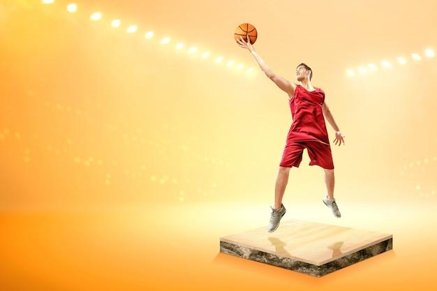 Basketteur asiatique avec le ballon saute en l'air Photo Premium