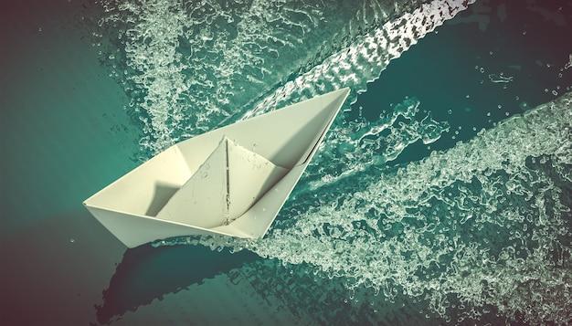Bateau En Papier Navigue Sur La Mer. Photo Premium