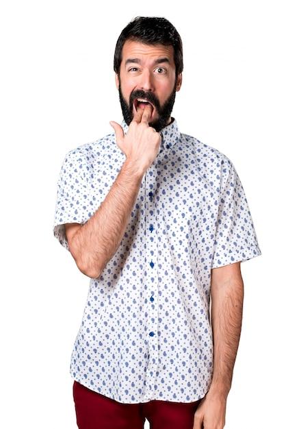 Beau homme brune à la barbe faisant un geste de vomissement Photo gratuit