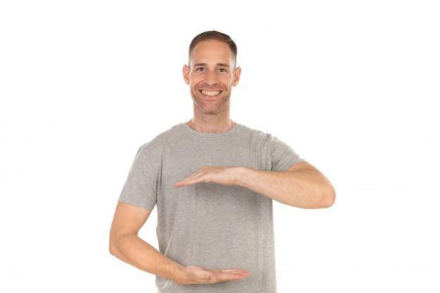 Beau mec pointant quelque chose avec ses mains Photo Premium