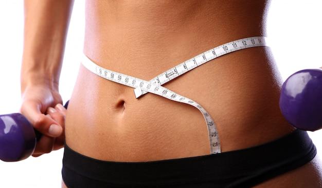 Beau ventre avec mètre et sous-vêtement Photo gratuit