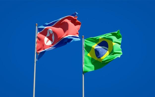 Beaux Drapeaux D'état National De La Corée Du Nord Et Du Brésil Ensemble Sur Ciel Bleu Photo Premium