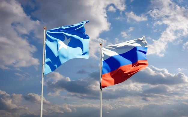 Beaux Drapeaux D'état National De La Somalie Et De La Russie Ensemble Sur Le Ciel Bleu. Illustration 3d Photo Premium