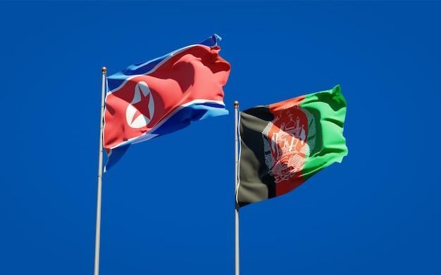 Beaux Drapeaux Nationaux De L'afghanistan Et De La Corée Du Nord Photo Premium