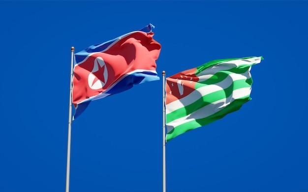 Beaux Drapeaux Nationaux De La Corée Du Nord Et De L'abkhazie Ensemble Photo Premium