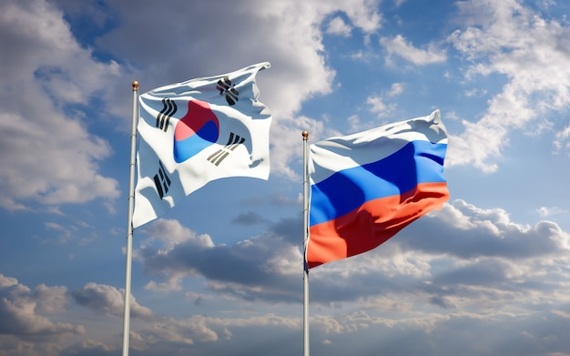 Beaux Drapeaux Nationaux De La Corée Du Sud Et De La Russie Ensemble Sur Le Ciel Bleu. Illustration 3d Photo Premium