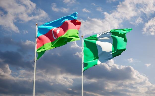 Beaux Drapeaux Nationaux Du Nigeria Et De L'azerbaïdjan Ensemble Sur Ciel Bleu Photo Premium