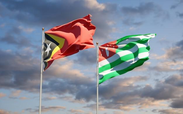 Beaux Drapeaux Nationaux Du Timor Oriental Et De L'abkhazie Ensemble Photo Premium