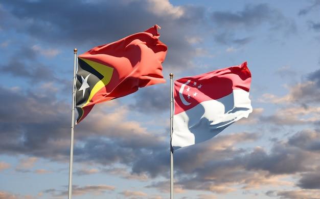 Beaux Drapeaux Nationaux Du Timor Oriental Et De Singapour Ensemble Photo Premium