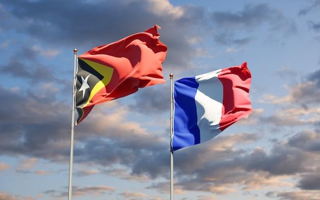 Beaux Drapeaux Nationaux De La France Et Du Timor Oriental Ensemble Au Ciel Photo Premium