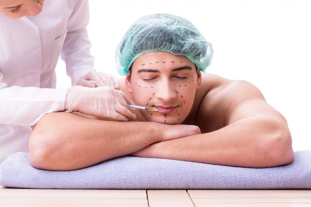 Bel homme dans le concept de massage spa Photo Premium