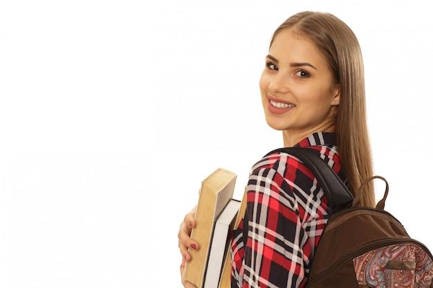 Belle étudiante avec un sac à dos Photo Premium