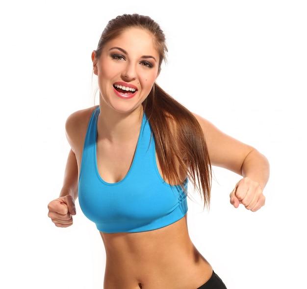 Belle femme active dans une tenue de fitness Photo gratuit