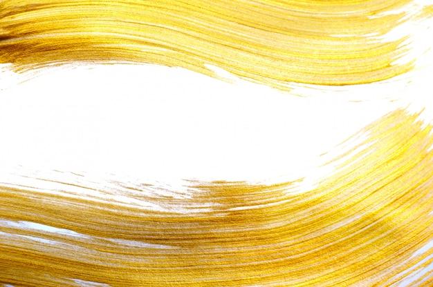 Belle grande or abstrait avec un pinceau acrylique Photo Premium