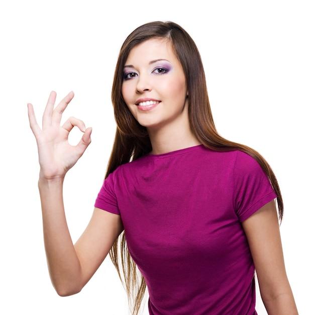 Belle Jeune Femme Avec Un Geste Correct Isolé Sur Blanc Photo gratuit
