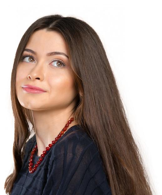 Belle jeune femme visage agrandi Photo Premium