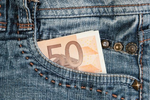 Billets en euros en poche Photo Premium