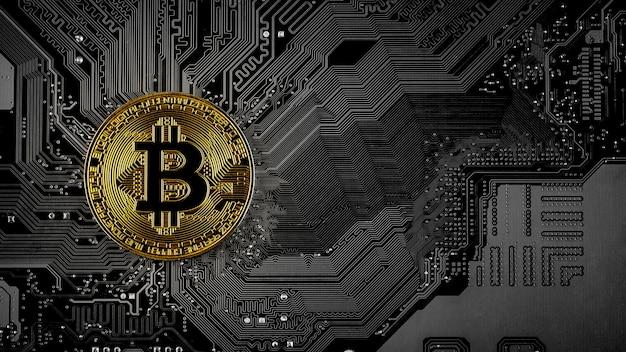 Bitcoins dorés sur circuit imprimé. Photo Premium
