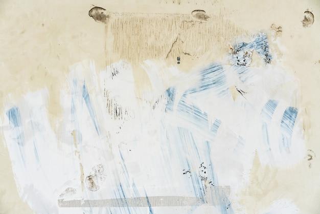 Blanc rugueux peint sur un mur en acier pour couvrir le texte à pulvériser. Photo Premium