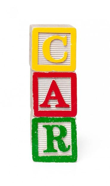 Blocs de l'alphabet coloré. voiture de mot isolé Photo Premium