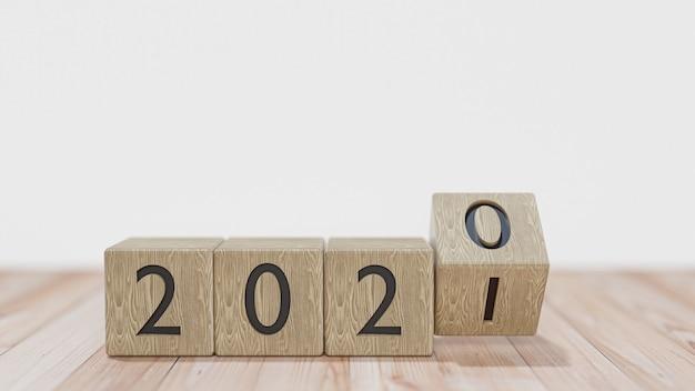 Blocs De Bois Avec La Transition De L'année 2020 à 2021 Sur Un Mur Blanc. Rendu 3d. Photo Premium