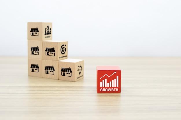 Blog De Jouets En Bois Cube Empilé Avec Icône Graphique Et Magasin D'icônes De Marketing De Franchise. Photo Premium