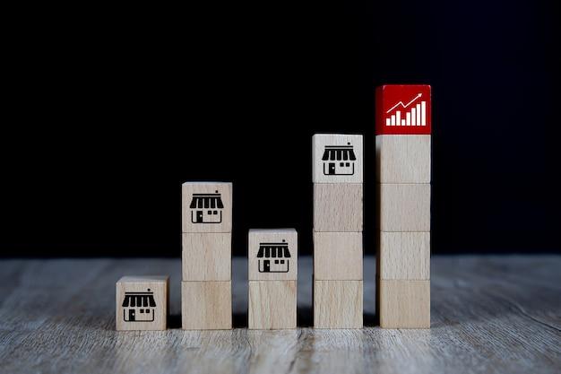 Blogs De Jouets En Bois Cube Avec Icône De Magasin De Marketing De Franchise Et Icône De Graphique. Photo Premium