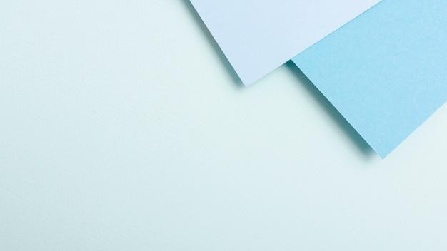 Blue toned collection de feuilles de papier avec espace de copie Photo gratuit