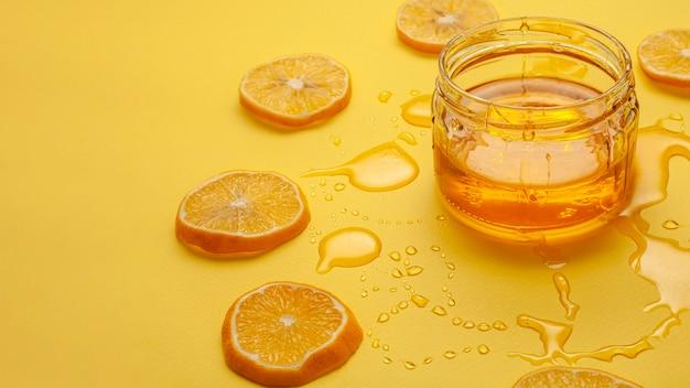 Bocal Avec Du Miel Et Des Citrons Photo gratuit
