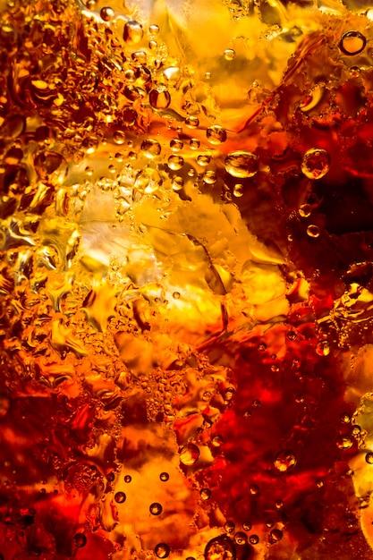 Boisson de cola avec la texture et la bulle de glaçons | Télécharger des Photos Premium