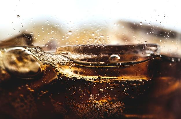 Boisson gazeuse cola macro shot Photo gratuit