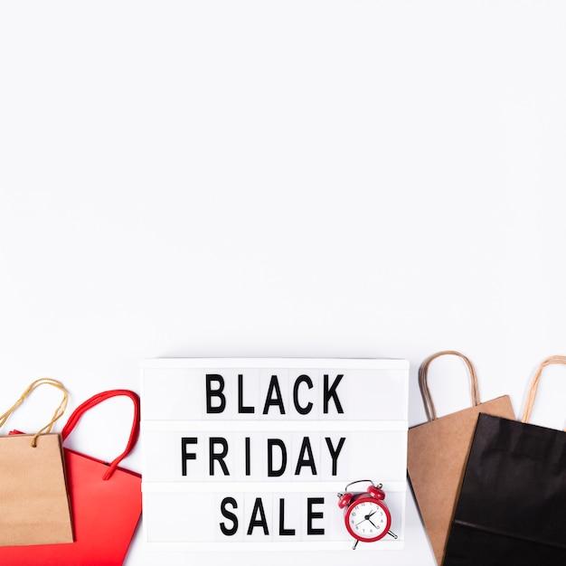 Boîte à lumière vente vendredi noir avec réveil Photo gratuit