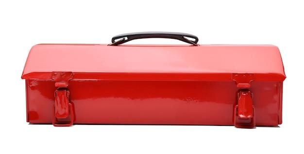Boîte à outils en métal rouge isolé sur fond blanc. Photo Premium