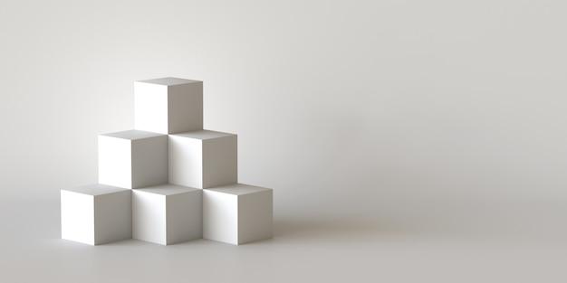 Boîtes de cube blanc avec fond de mur blanc blanc Photo Premium